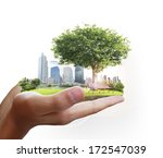 human hand holding the city  | Shutterstock . vector #172547039