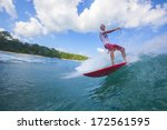 surfing a wave | Shutterstock . vector #172561595