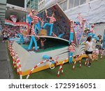 Small photo of Temporary Where's Wally exhibition with a large book outside the Harbour City Mall. Hong Kong - 9th August 2015