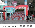 Small photo of Temporary Where's Wally exhibition with a sign and design on the steps outside the Harbour City Mall. Hong Kong - 9th August 2015