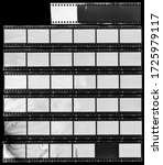 Small photo of Seven long and empty 35mm filmstrips on black background.