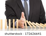 businessman hand stop dominoes... | Shutterstock . vector #172626641
