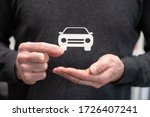 Man holding a paper car; Concept of auto insurance - stock photo