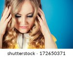 frustrated young woman on blue... | Shutterstock . vector #172650371