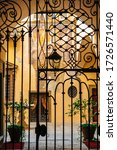 Beautiful arched wrought iron gates to the old courtyard