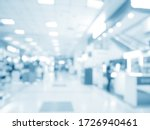 Small photo of abstract medical background for design. Blurred dispense counter of hospital or clinical with people.
