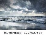 Rough Sea And Sandy Beach.