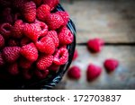 raspberries in a basket on... | Shutterstock . vector #172703837