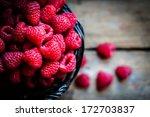 raspberries in a basket on... | Shutterstock . vector #172703837