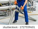 Factory Worker Operate With...