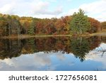 Autumn reflections over the Chippewa River at Brunet Island State Park in Wisconsin.