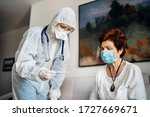 Home Care Doctor Wearing...