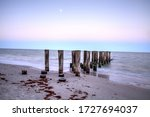 Dilapidated Pier Leading Into...
