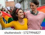 Young women on street enjoying...