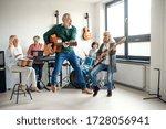 Group of senior people playing...