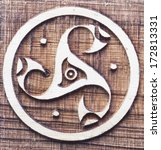 Small photo of Former Celtic triskele symbol carved wooden circle