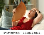 Adult Woman Fanning Suffering...