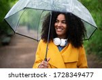 A Young Woman With Rain Jacket...
