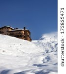Off Piste Slope And Hotel At...