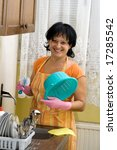 woman washing dishes in the... | Shutterstock . vector #17285542