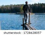 Man Standing At Looking At Lake ...