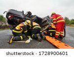 Small photo of Senov, Czech republic - september 11 2015: Firefighters and paramedics practice rescuing and extrication people from crashed vehicles