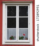 flowers in a window of a red... | Shutterstock . vector #172892951