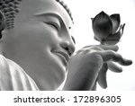 Face Of A White Buddha With A...