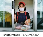 Fast Food Cashier In Drive Thr...