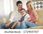 happy young family using tablet ... | Shutterstock . vector #172905707
