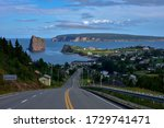 Scenic view up the hill of the village harboring the famous Rocher Percé in Gaspesie at dusk.