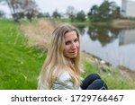 woman girl sitting on a grass... | Shutterstock . vector #1729766467