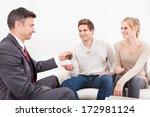salesman handing car key to... | Shutterstock . vector #172981124