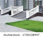 A Wide Marble Staircase With...