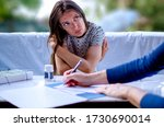 Small photo of Young Woman at Psychiatrist talking about mental problems.Beautiful female at Therapist session.Anxious Woman visit to her shrink for expert advice
