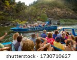 Small photo of Rogue River, Oregon - 8/5/2014: Tourists on a Jet Boat riding on the Rogue River
