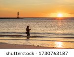 Sunrise Greets A Single Surf...