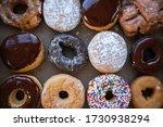 Sweet Dozen Of Donuts In Paper...