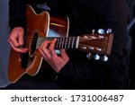 Hands Holding A Guitar. Make...