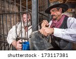 Sheriff Tends To A Prisoner In...