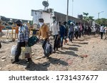 Small photo of MUMBAI/INDIA - MAY 14, 2020: Crowd of migrant workers outside railway terminus for boarding a special train back home during a nationwide lockdown.