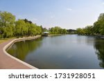 City park with pond in Wonsan shown before sunset, North Korea
