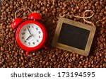 Alarm clock and chalk blackboard for text on a coffee beans. - stock photo