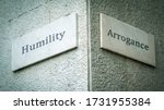 Small photo of Street Sign the Direction Way to Humility versus Arrogance