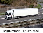 WIEHL, GERMANY - APRIL 4, 2020: Iveco Rent truck with temperature controlles trailer on motorway. - stock photo