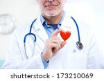 doctor holding an heart ... | Shutterstock . vector #173210069