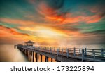 Small photo of Wooded bridge in the port between sunrise.