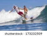 surfing a wave  | Shutterstock . vector #173232509