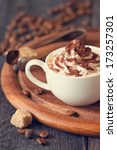 Cup of cappuccino coffee with whipped cream and chocolate. Toned photo. - stock photo