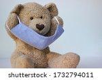 Teddy Bear Putting On...